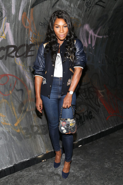 Serena Williams contrasted her sporty top with sexy skintight jeans.