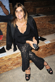 Carine Roitfeld teamed a black henley shirt with a blazer and lace pants for the Coach 1941 fashion show.