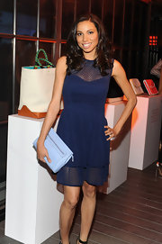 Jurnee Smollett chose a navy frock that featured a delicate lace overlay for her fun and flirty look at Coach's CDF event.