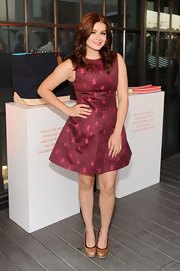 Ariel Winter looked classy in crimson when she sported this A-line frock, featuring a unique insect-print.