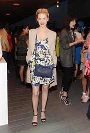 January Jones matched her shoulder bag to her dress when she carried this deep blue leather bag.