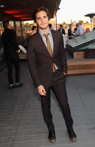 Diego Boneta opted for a chocolate brown suit and light brown tie for a cool and contemporary evening look at Coach's 3rd Annual Evening of Cocktails and Shopping.