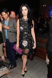 Katy Perry looked stunning in a dandelion-print frock, which featured a sheer lace hemline.