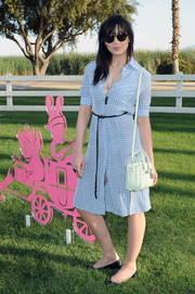 Daisy Lowe was cute and youthful in a blue gingham button-down shirtdress by Altuzarra at the Coach Backstage event.