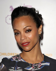 Actress Zoe Saldana attended the Children's Defense Fund wearing a pair of Polished Rock Candy teardrop earrings in black shell.