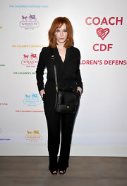 Christina Hendricks maintained her monochromatic look with a classic black leather Station satchel.