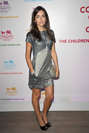 Camilla Belle accented her silver cap sleeve dress with a matching metallic leather Kristin embossed python purse.