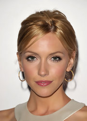 Katie Cassidy added a dash of pink lip gloss to her bronzed cheek at the Children's Defense Fund.