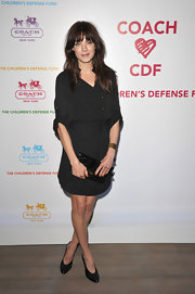 Michelle Monaghan accented her black shirt dress with a matching crocodile flap clutch.