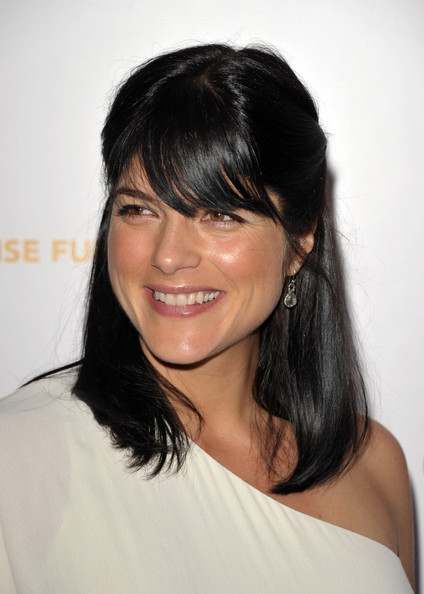 Selma Blair styled her shoulder length hair in a half up half down hairstyle for the Children's Defense Fund benefit.