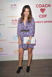 Sophia Bush's white gathered leather Madison clutch popped against her ditsy floral print dress.