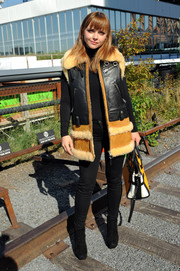 Christina Ricci looked winter-ready in her Coach biker sheepskin vest during the label's fashion show.