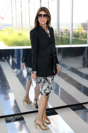 Carine Roitfeld was all business in a double-breasted jacket layered over a print dress at the Coach fashion show.