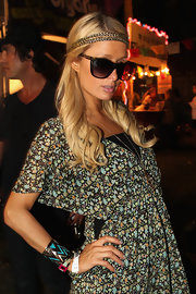 Paris Hilton attended the Coachella music festival wearing a black-and-turqouise Tribal bracelet.