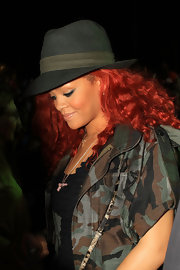Rihanna wore a cool olive and khaki fedora to complement her camo jacket at Coachella.