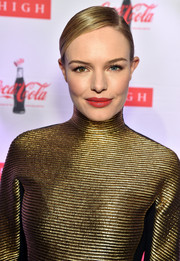 Kate Bosworth attended the 'Coca-Cola Bottle: An American Icon at 100' exhibition wearing her usual sleek bun.