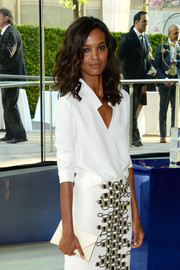 Liya Kebede teamed a white envelope clutch with a wrap top and a patterned skirt for the CFDA Fashion Awards.