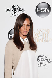 Joan Smalls wore her hair in a long sleek style with lengthy side-swept bangs for the 'Snow White and the Huntsman' collection launch for HSN.