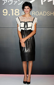 Audrey dons a unique combination on the red carpet. This lace and leather look is both girly and rough.