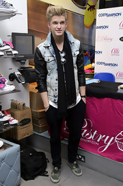 Cody Simpson opted for a funky denim jacket with leather sleeves that gave him a bit of a rock 'n roll edge at a fan signing in London.