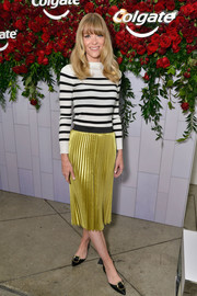 Jaime King dressed up her casual top with a pleated chartreuse skirt.