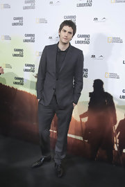 Jim hit the premiere of 'The Way Back' wearing a charcoal gray suit and matching button down shirt.