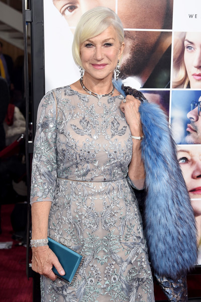 Helen Mirren accessorized with a super-elegant blue satin box clutch by Judith Leiber at the world premiere of 'Collateral Beauty.'