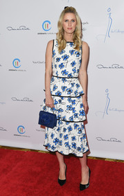 Nicky Hilton tied her look together with a blue floral satin purse by Oscar de la Renta.