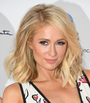Paris Hilton rocked a voluminous wavy 'do at the Colleagues and Oscar de la Renta spring luncheon.