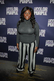 Danielle Brooks chose a pair of black-and-white striped pants to finish off her outfit.