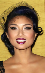 Jeannie Mai punched up her retro look with sparkling berry lips. A nice contrast when paired to her midnight blue streaked hair.