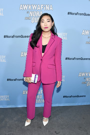 Awkafina looked smart in a fuchsia pantsuit at the premiere of 'Awkwafina is Nora from Queens.'