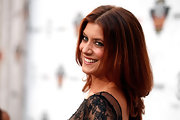 Kate Walsh wore her hair smooth with lots of body at the Comedy Central Roast of Charlie Sheen. To recreate Kate's look, apply a product like Rene Furterer Control Emulsion Anti-Frizz to damp hair and blow-dry with a large round brush.