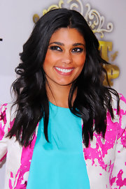 Designer Rachel Roy wore polished wavy locks to the Comedy Central Roast of Donald Trump.