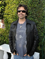 Greg wears his sporty tortoise shell sunglasses outside of Joan River's Roast.