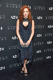 Riley Keough tied her look together with a gray Louis Vuitton Petite Malle clutch.