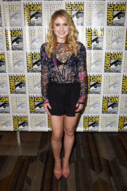 Pink suede pumps completed Rose McIver's breezy outfit.