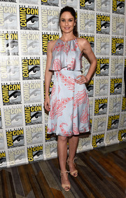 Sarah Wayne Callies went the ultra-girly route in a silver and red print dress with a layered bodice for Comic-Con International 2016.