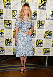 Claire Coffee looked fresh as a summer's day in a vintage blue floral dress during Comic-Con International 2016.