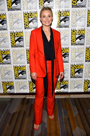 Kristen Bell looked sharp in a red Anine Bing pantsuit teamed with a black shirt at the 'Good Place' press line during Comic-Con International.