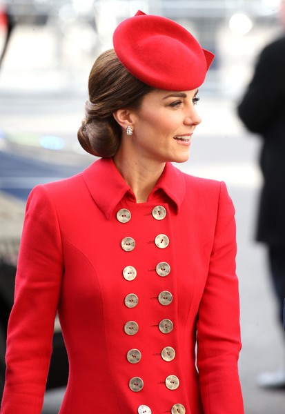 Kate Middleton matched her Catherine Walker coat with a red fascinator for Commonwealth Day service.