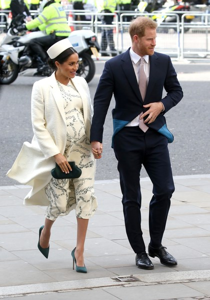 Meghan Markle added a hint of color with a pair of green satin pumps by Victoria Beckham.