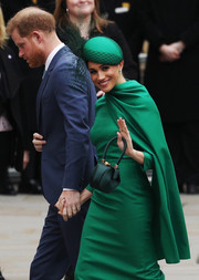 Meghan Markle matched her dress and purse with a green William Chambers hat for the 2020 Commonwealth Day Service.