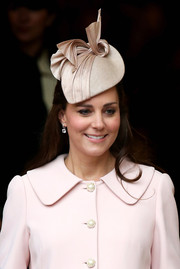 Kate Middleton attended the Commonwealth Day service wearing a nude decorative hat by Jane Taylor.