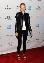 Leelee Sobieski topped off her look with a tough-chic leather jacket.