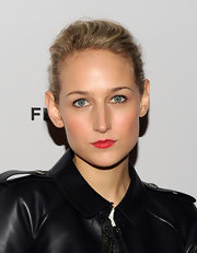 Leelee Sobieski added a pop of cherry red to her fresh-faced look with a touch of matte lipstick.