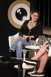 Kristen Stewart teamed her top with ripped jeans.