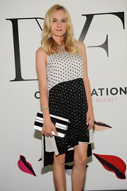 Diane Kruger carried this black-and-white striped clutch with her dotted dress at the DVF studio event.