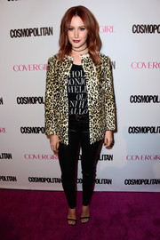 Ashley Tisdale wore a leopard-print fur jacket for a chicer finish to her look.