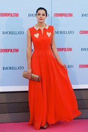 Ana Rujas wore a sleeveless red dress with blush pink heart detailing and a Peter Pan collar.